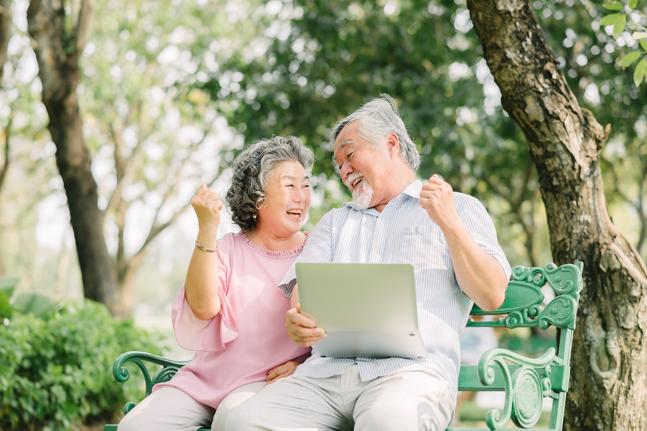 A senior couple researching possible retirement options