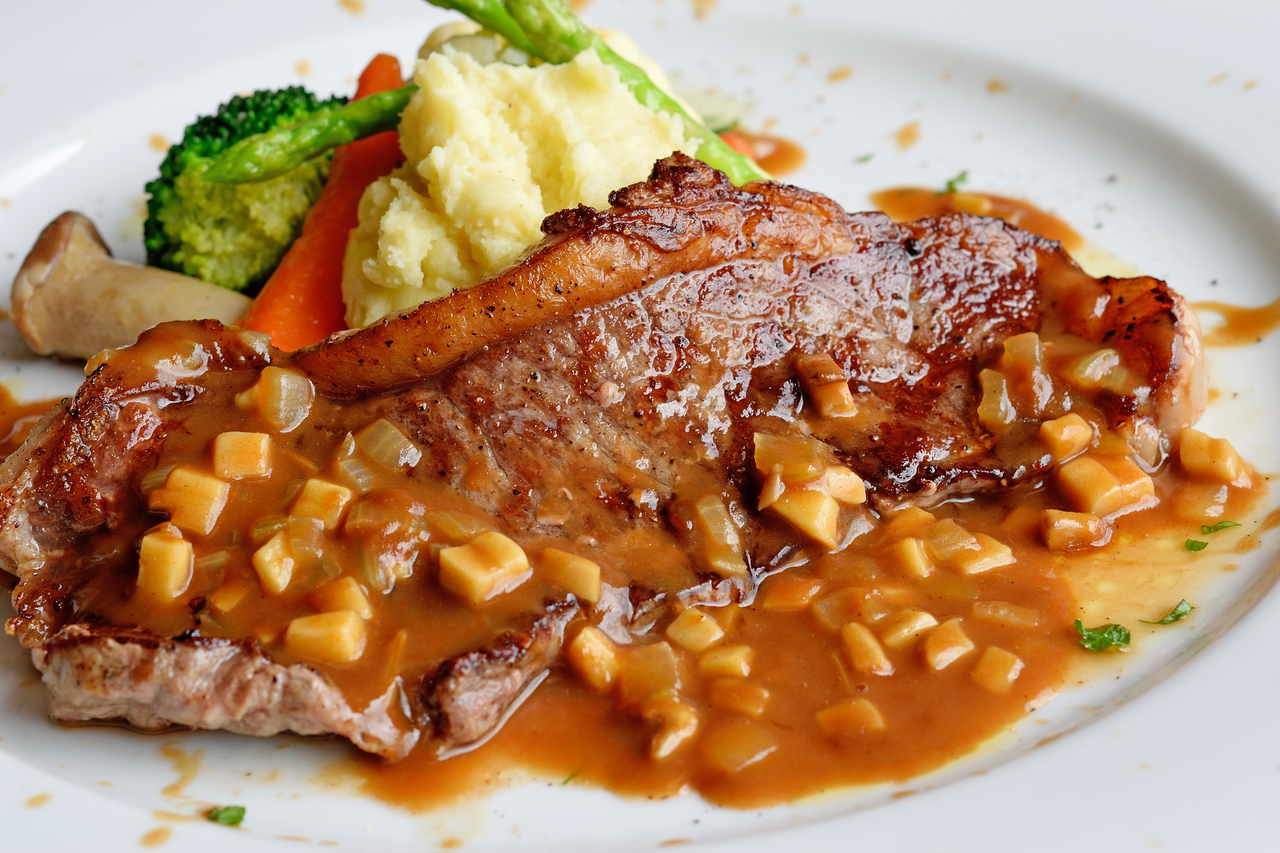Steak with mashed potato and gravy