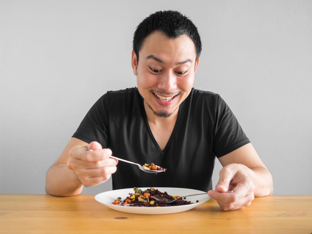An Asian man eating a dish from Batangas