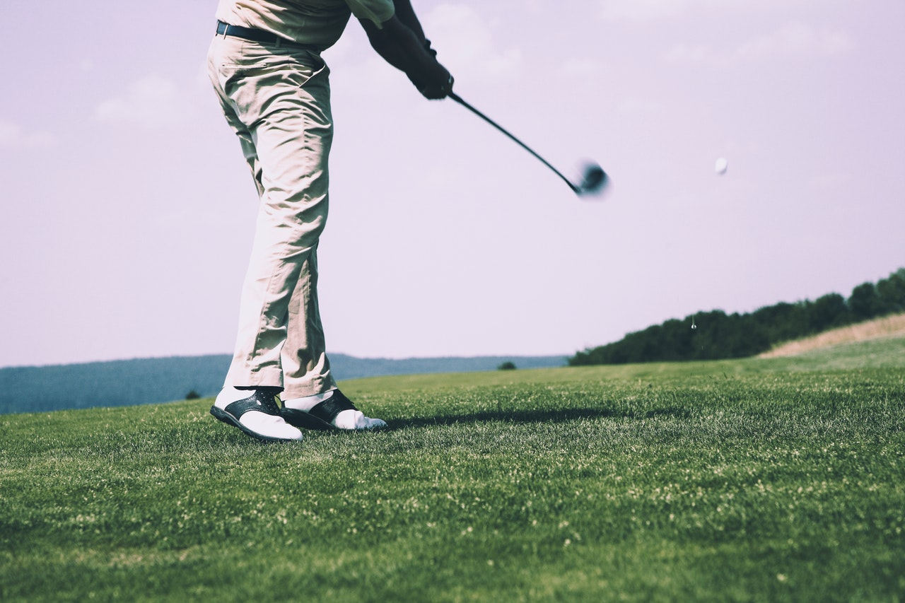 A man warming up for a game of golf