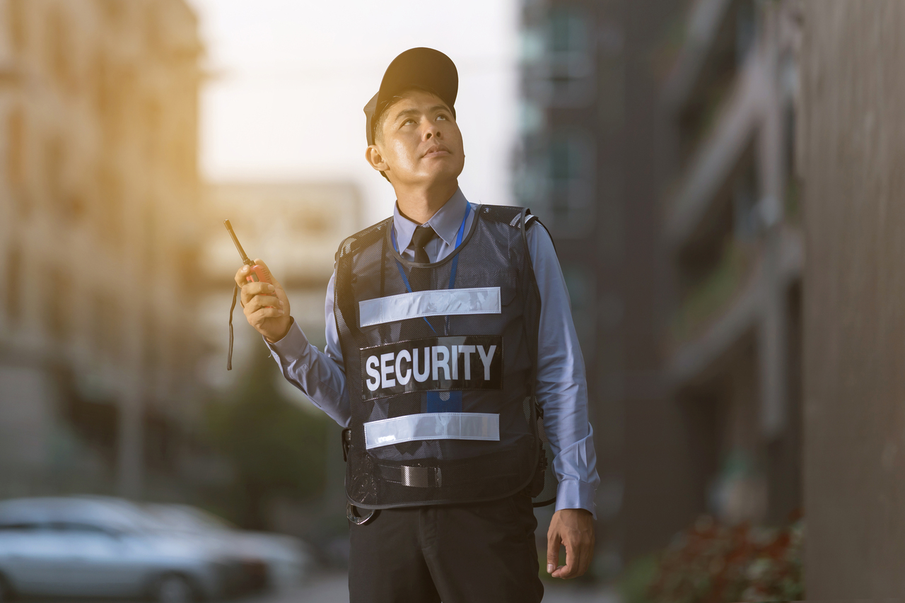 A security guard in a residential area