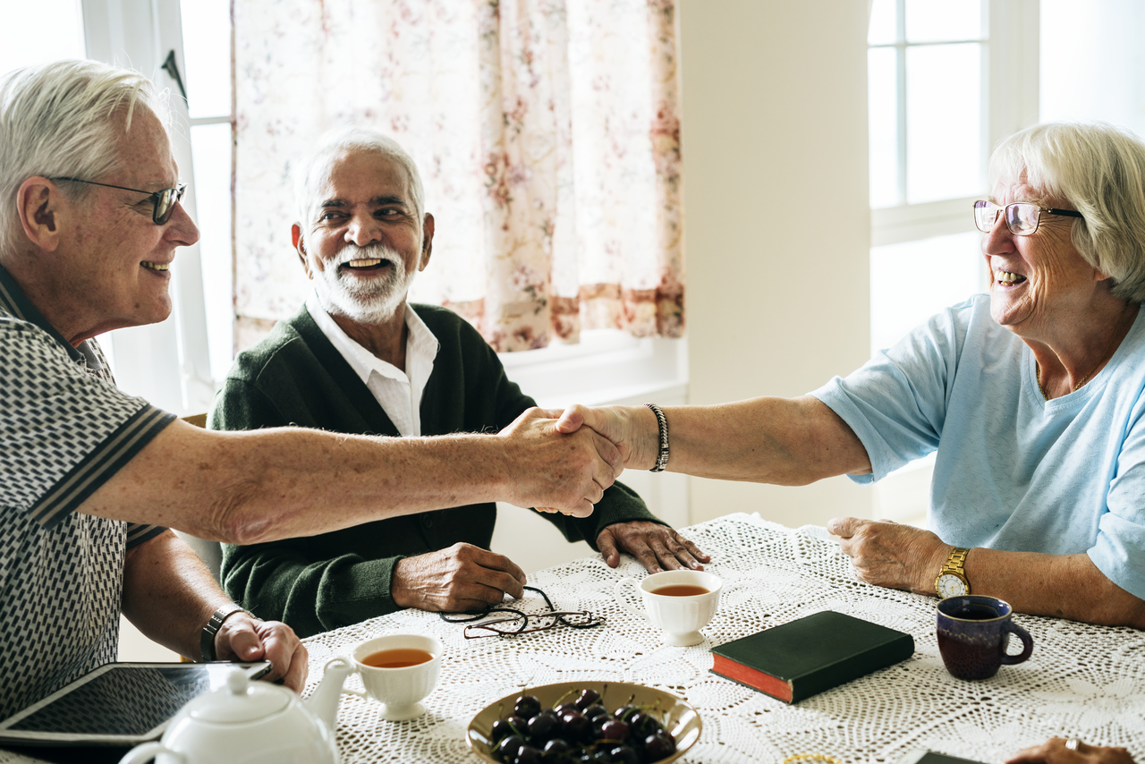 Elderly neighbors meeting for the first time