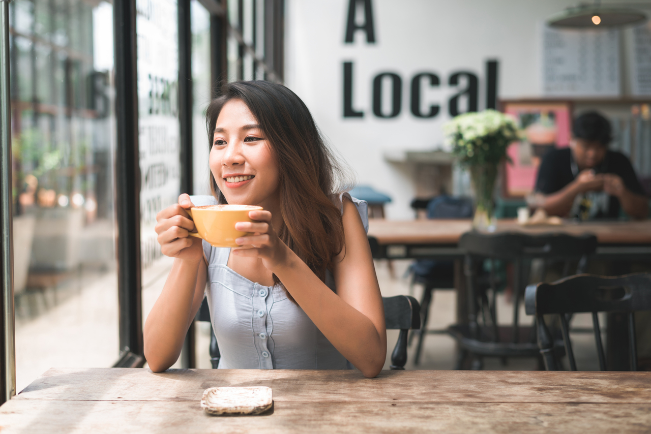 A woman at a coffee shop