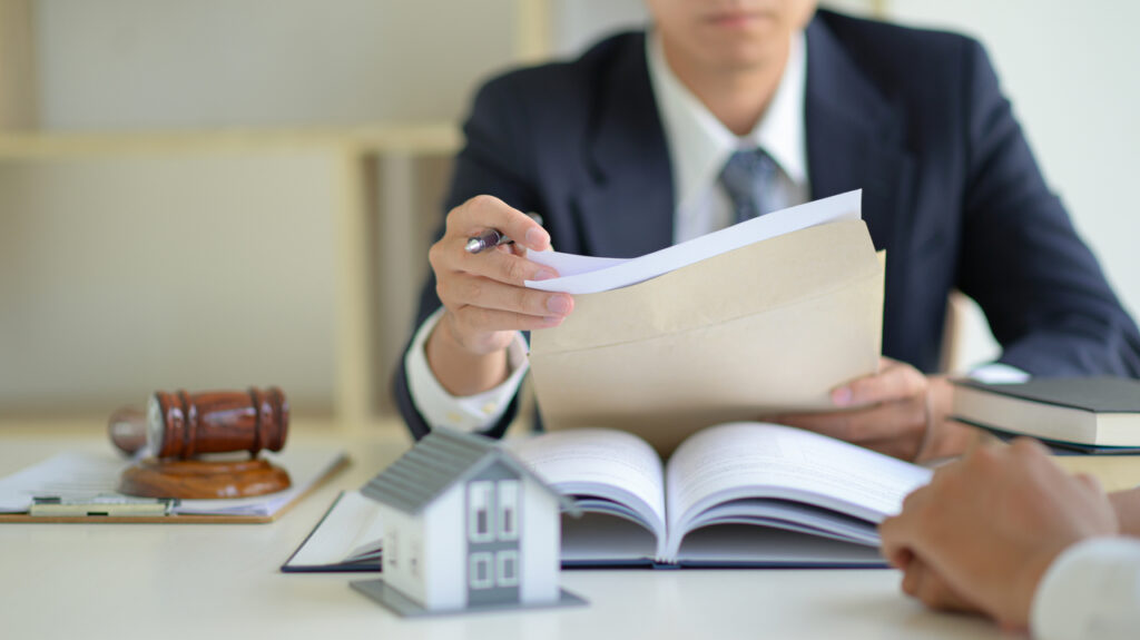 A lawyer overseeing contract of a newly bought house