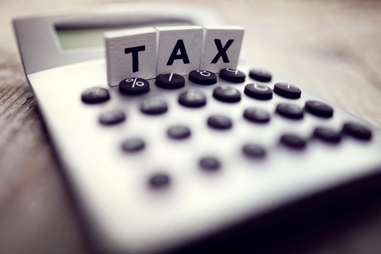 A calculator with tax written on blocks